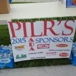 PILR's 2015 Sponsors Poster. 2015 Sponsors shown on sign include Sonic, Dollar Sense, Tammy Fuhr, Jake Fletchall, Dillions, K Mart, Spangles, Chris & Dan Owens, and Tyson.
